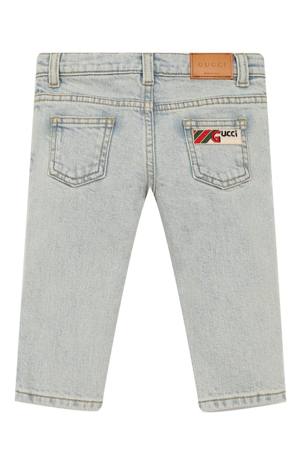 Детские джинсы с декоративными потертостями GUCCI голубого цвета, арт. 540362/XDAC8   Фото 2