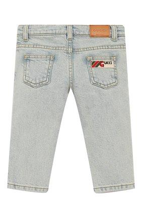 Детские джинсы с декоративными потертостями GUCCI голубого цвета, арт. 540362/XDAC8 | Фото 2